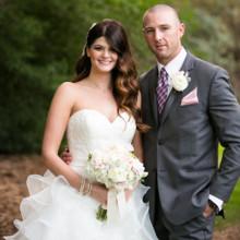 "<strong class='info-row'>Boone & Stacie Weddings</strong> <div class='info-row description'><html>  <head></head>  <body>    Venue:    <a href=""http://www.weddingwire.com/biz/temecula-creek-inn-temecula/be984ba804259531.html?utm_source=ww&utm_medium=photo-gallery&utm_campaign=real-weddings"" target=""_blank"">Temecula Creek Inn</a>  Dress Designer:    <a href=""http://www.weddingwire.com/wedding-photos/dresses/allure-bridals?utm_source=ww&utm_medium=photo-gallery&utm_campaign=real-weddings"" target=""_blank"">Allure Bridals</a> from    <a href=""http://www.weddingwire.com/reviews/mary-me-bridal-orange/2f9c7fd718393ffe.html?utm_source=ww&utm_medium=photo-gallery&utm_campaign=real-weddings"" target=""_blank"">Mary Me Bridal</a>  Shoes:    <a href=""http://www.converse.com/"" target=""_blank"">Converse</a>  Bridesmaid Dresses: Hailey Logan from    <a href=""http://shop.nordstrom.com/"" target=""_blank"">Nordstrom</a>  Groom and Groomsmen Attire:   <a href=""http://www.menswearhouse.com/"" target=""_blank"">Men's Wearhouse</a>  Floral Designer:   <a href=""http://www.weddingwire.com/biz/flowers-etc-fountain-valley/5b3e8c931fc00f2b.html?utm_source=ww&utm_medium=photo-gallery&utm_campaign=real-weddings"" target=""_blank"">Flowers Etc</a>.  Cake:   <a href=""http://www.weddingwire.com/biz/nothing-bundt-cakes-corte-madera/20b5b8914d4bddfa.html?utm_source=ww&utm_medium=photo-gallery&utm_campaign=real-weddings"" target=""_blank"">Nothing Bundt Cakes</a>  Jewelry: Caitlizlee  Hair Stylist: Ashleigh Alvarez  Makeup Artist: Christina Sandoval  Officiant: Jay Hewitt  Invitations: Melissa Weisbender  DJ: Able Productions     </body> </html></div>"