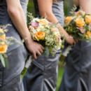 Venue: Knollwood Country Club  Bridesmaid Dresses: Kay's Bridal