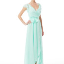 Dorian Long Ethereal chiffon composes this romantic dress. The tulip wrap skirt shows a peek of leg, and chiffon sashes tie at the waist. Elegant crossover V neckline and ruffled cap sleeves. Variety of colors available