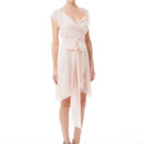 Dorian Short Ethereal chiffon composes this romantic dress. The knee length, tulip wrap skirt shows a peek of leg, and chiffon sashes tie at the waist. Elegant crossover V neckline and ruffled cap sleeves. Variety of colors available