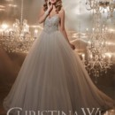 Style 15553 is the perfect fairytale wedding dress. With its heavily encrusted rhinestone bodice and sweetheart neckline, it's impossible to not feel like a princess in this gown. The ball gown sillhouette flows into a pleated tulle skirt, finished off with a zipper back.
