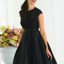This cute little bridesmaid dress has a wonderful jewel neckline has a sheer yoke bodice, cap sleeves, keyhole back and full skirt with a band and bow at the empire. Style 22342 is a great combination of chic and elegance!