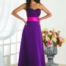 This bridesmaid dress has a strapless sweetheart neckline. And a criss cross bust with a pleated tear banding at the empire waist. Style 22346 will look great at any wedding.
