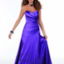 This strapless bridesmaid dress has a sweetheart neckline. With a fitted gown and drop waist, this dress looks stunning on anyone!