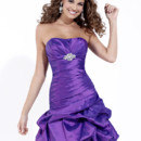 A stylish bridesmaid dress, style 22475 features a pleated bodice and dropped waist that then tapers into a short pick up skirt.