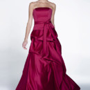 Style 22521 is a beautiful long, flowing, faux two-piece bridesmaid dress with a sash at the waist. This A-line gown drops to the floor and is carefully made in satin fabric.
