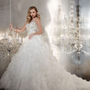 Style 15545 This tank-style ball gown features an illusion v-neck, beaded bodice which then elegantly flows into a tiered and ruffle organza skirt. Style 15545 is a gorgeous bridal gown.