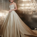 Style 15538 is a strapless A-line satin gown with basque waist and box pleats. The heavily beaded lace bodice and beaded hem lace really accentuate the bride.