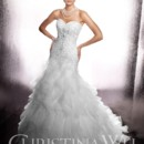 Christina Wu 15449  Style 15449 is a stunning strapless trumpet gown with dazzling beading on the bodice which continues into a full skirt and train made of handkerchief-style organza layers.