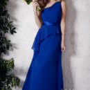 Christina Wu Occasions Style 22657 One-shoulder slim A-line gown with short side drape and satin band at waist.