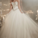 Christina Wu Style 15574 Full tulle ball gown with bead detailing on the Basque-waist bodice with a sweetheart neckline.