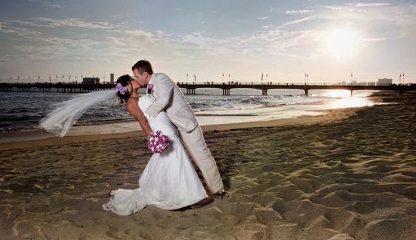 1419015325007 Dramatic Beach Wedding Kiss Denver  wedding photography