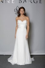 Style: Swansea Strapless bodice of Alencon lace with charmeuse cummerbund and fishtail skirt of organza.