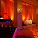 Customized monogram gobo on dance floor, pipe & drape for stage area, pin spot for cake and sweet heart table and ambient up lighting