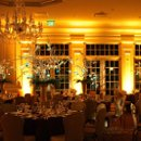 130x130 sq 1261663406486 meadowwoodmanoruplightinginamberandpinspottingofcenterpieces2