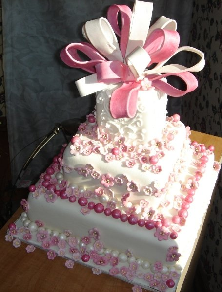 1217760069497 3tierweddingorbirthdaycakewithpinksugarsculpturebows,pearlsandflowers Greenville wedding cake