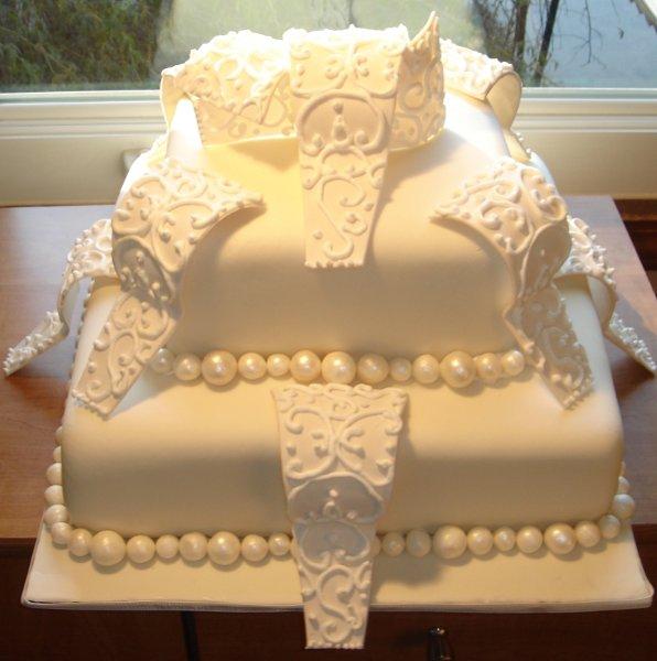 1229052029674 2tierweddingcakewithsugarsculpturecurlicuesandsugarpearls Greenville wedding cake