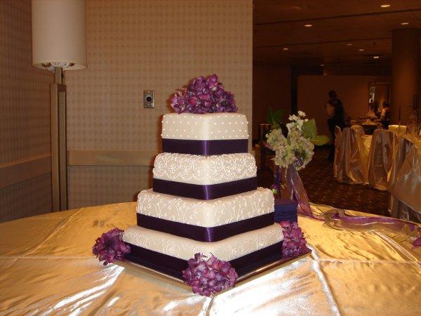 1229052194767 Fondantweddingcakewithscrollwork,purpleribbonandflowers010 Greenville wedding cake