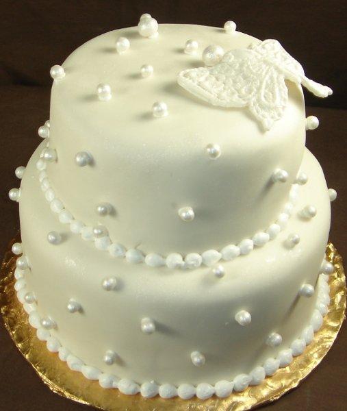 1229052330877 Twotierwhitefondantweddingcake004 Greenville wedding cake