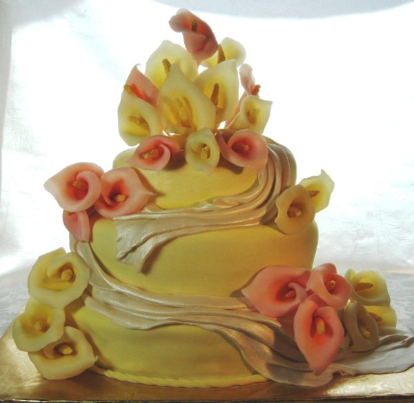 1231114225906 3tieryellowfondantcakewithyellowandpinkcallalillies Greenville wedding cake