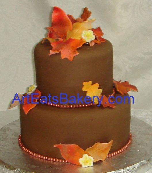 1255044319801 Chocolatebrowntwotiedfondantfallleavesbirthdaycake Greenville wedding cake