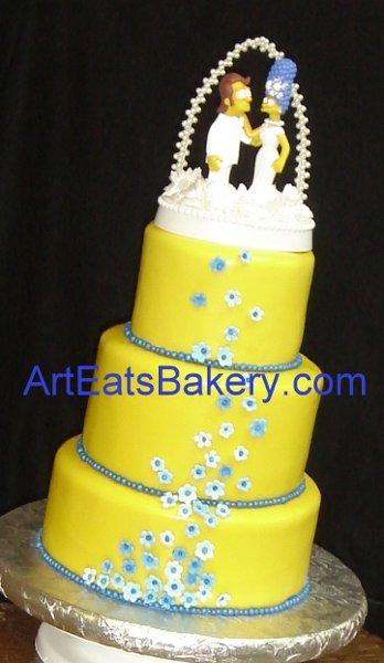 1255044400145 SimpsonsyellowfondantweddingcakewithMargeandHomertopper Greenville wedding cake