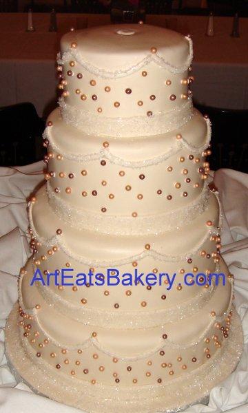 1255044406208 Fourtierivoryfondantweddingcakewithsugarcrystalsandbrownandgoldpearls Greenville wedding cake