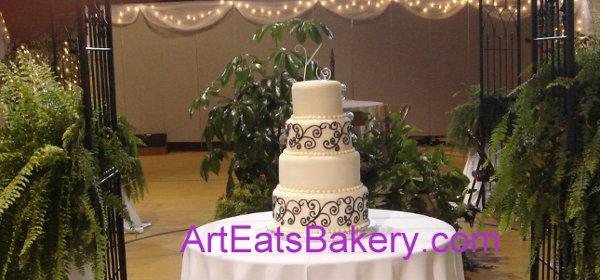1255044547801 Fondantfourtierweddingcakewithfreehandblackscrolls Greenville wedding cake