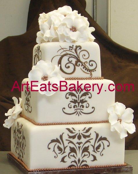 1279494520468 Threetiersquareivoryfondantcustomweddingcakewithbrowndesignsandwhiteflowers Greenville wedding cake