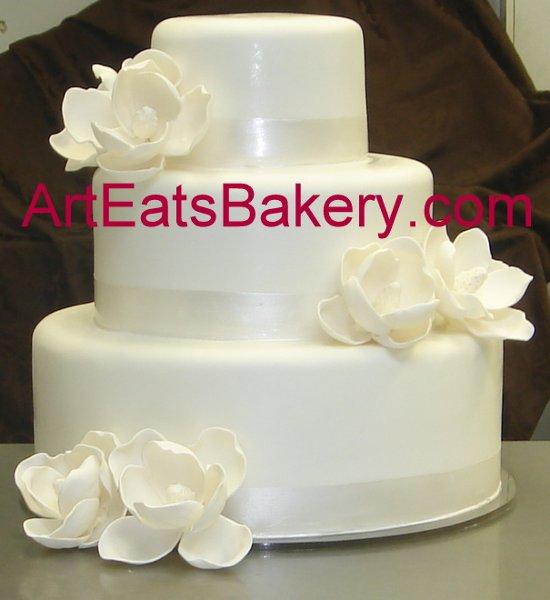 1279494532359 Threetierwhitefondantcustomsugarmagnoliasweddingcake Greenville wedding cake