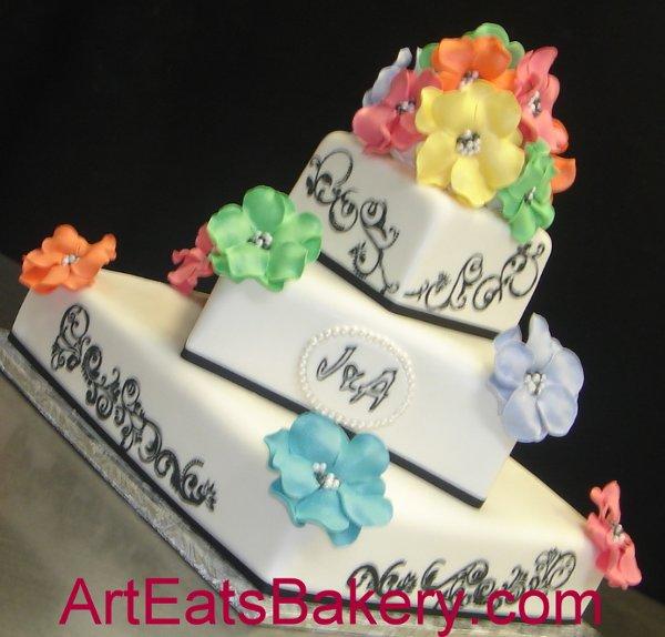 1279494565234 Treetierblackandwhitefondantsquareweddingcakewithrainbowcoloredsugarflowers Greenville wedding cake