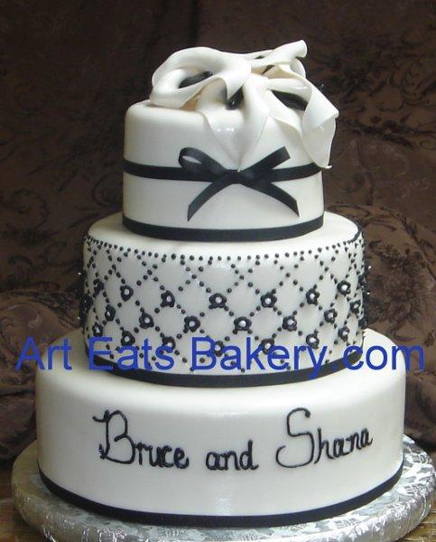 1279494603062 Threeblackandwhitecustomweddingcakewithgumpastecallalillies Greenville wedding cake