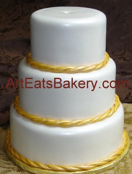 1308526759239 Threetierpearlfondantcustomweddingcakedesignwithgoldtwistedboarder Greenville wedding cake
