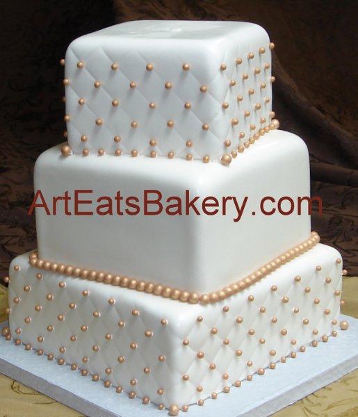 1308526768630 Threetiersquarefondantoffsetquiltandgoldpearlcustomweddingcakedesignpicture Greenville wedding cake