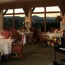 130x130 sq 1281134761855 diningroom