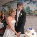 130x130 sq 1394045538640 couple cutting cak