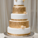 130x130 sq 1446063955863 gold and white cake sm