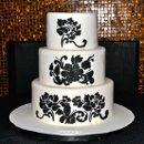 130x130_sq_1358896036687-flowershadowsweddingcake