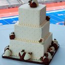 130x130 sq 1358896118487 tuxedostrawberrieson3tierweddingcake