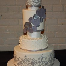 220x220 sq 1358895638970 delicatewithbuttercreamfrostingweddingcake