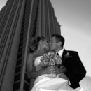 130x130_sq_1406821539463-bride-and-groom-with-skyscrapper