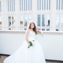 130x130 sq 1469465268640 bride on roof with arm over top