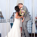 130x130 sq 1478533696774 bride and groom kissing under chuppah