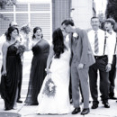 130x130 sq 1478533704840 bride and groom kissing withi bridal party black a