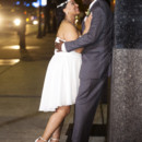 130x130 sq 1479138831694 bride and groom embrace at night on sidewalk