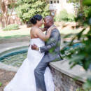 130x130 sq 1479138853775 bride and groom embrace by the fountain