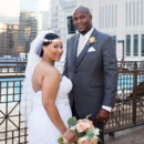 130x130 sq 1479138971599 bride and groom with skyscrapper close up