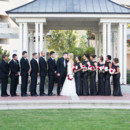 130x130 sq 1480696833670 bridal party with bride and groom kissing in front