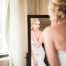 130x130 sq 1480697055180 bride looking into mirror