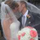 130x130 sq 1481034366700 bride and groom under veil kissing